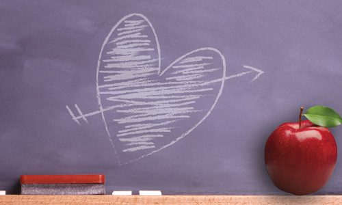 Chalboard with a heart and arrow drawn with chalk