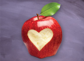 Apple with heart shape carved into it