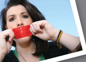 A women with her mouth covered by red tape
